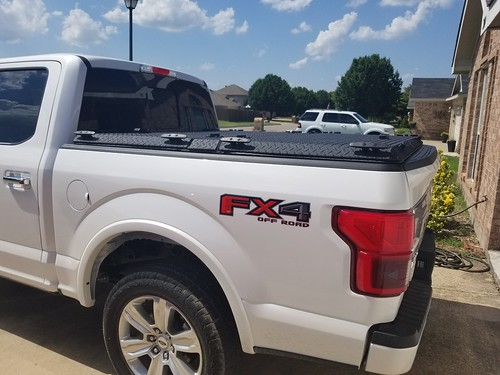 0030d00002fqsly aluminum ruggedblack diamondback truckbedcover tonneaucover driveway passengersideview ff15 hd c closed whitetruck ford f150 fx4 diamondplate noaccessories