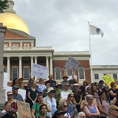 Protesting in humane treatment of families at the border. State House in Boston.