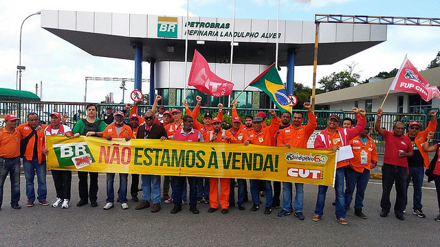 "Oil workers stand against privatization of state-owned oil giant Petrobras. The banner reads ""We're not for sale"" - Créditos: FUP Handout"