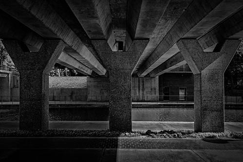 bw blackwhite blackandwhite bridge contrasts dark light monochrome sidewalk supports walkway water waterway woodlandswaterway woodlochforestdrive thewoodlands texas unitedstates us