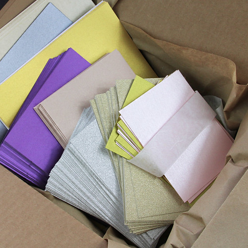 Box of paper sheets and card stock