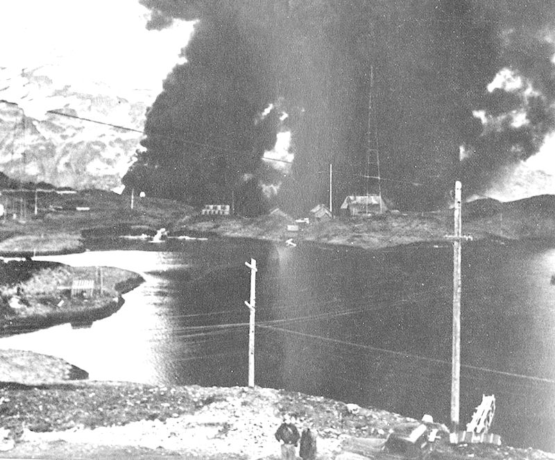 The Navy radio station at Dutch Harbor burning after the Japanese attack on June 4, 1942