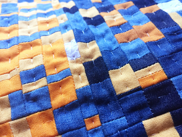 quilting the bits by hand.
