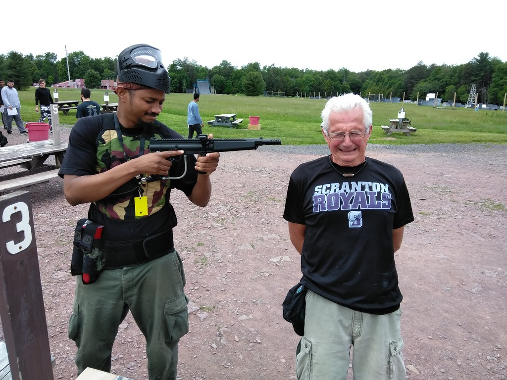 Bus driver Chuck Orlorki at a paintball facility--Albrightsville