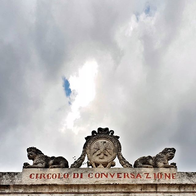 Circolo di conversazione #monument #writing #words #sicily #ragusaibla #ragusa #sicilia #igers #igersitalia #clouds #cloudy #lookingup #red #talk