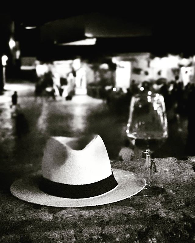 Hat and Wine #blackandwhite #black #bw #sicily #wine #glass #panamahat #white #picoftheday #photooftheday #retro #igers #igersitalia #beccacimmi #beccacimmiwedding