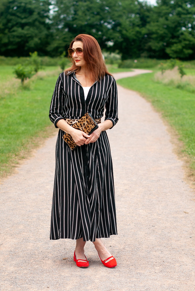 c654fc2e7cc ... How to Style a Summer Shirt Dress With Pattern Mixing   black and white  striped midi