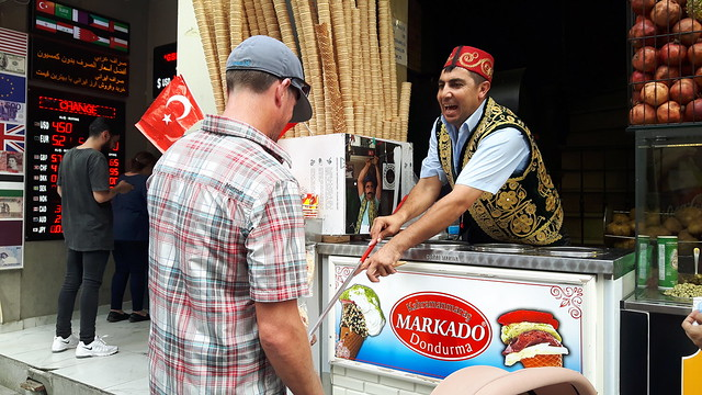 A man serving ice cream on a long stick in Istanbul, Turkey