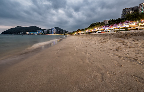 sanya china hainan beach water ocean sand sea shore landscape coast sky outdoor seashore outdoors travel cloud sandy seascape noperson cloudy sunset evening vacation lights dramatic relaxing wideangle tranquil tourism tourist