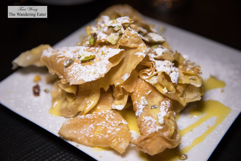 Bateeya - fried filo dough drenched in creme angalaise sauce, pistaciho