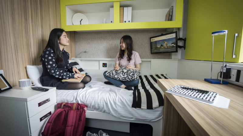 Students in a bedroom of The Quads