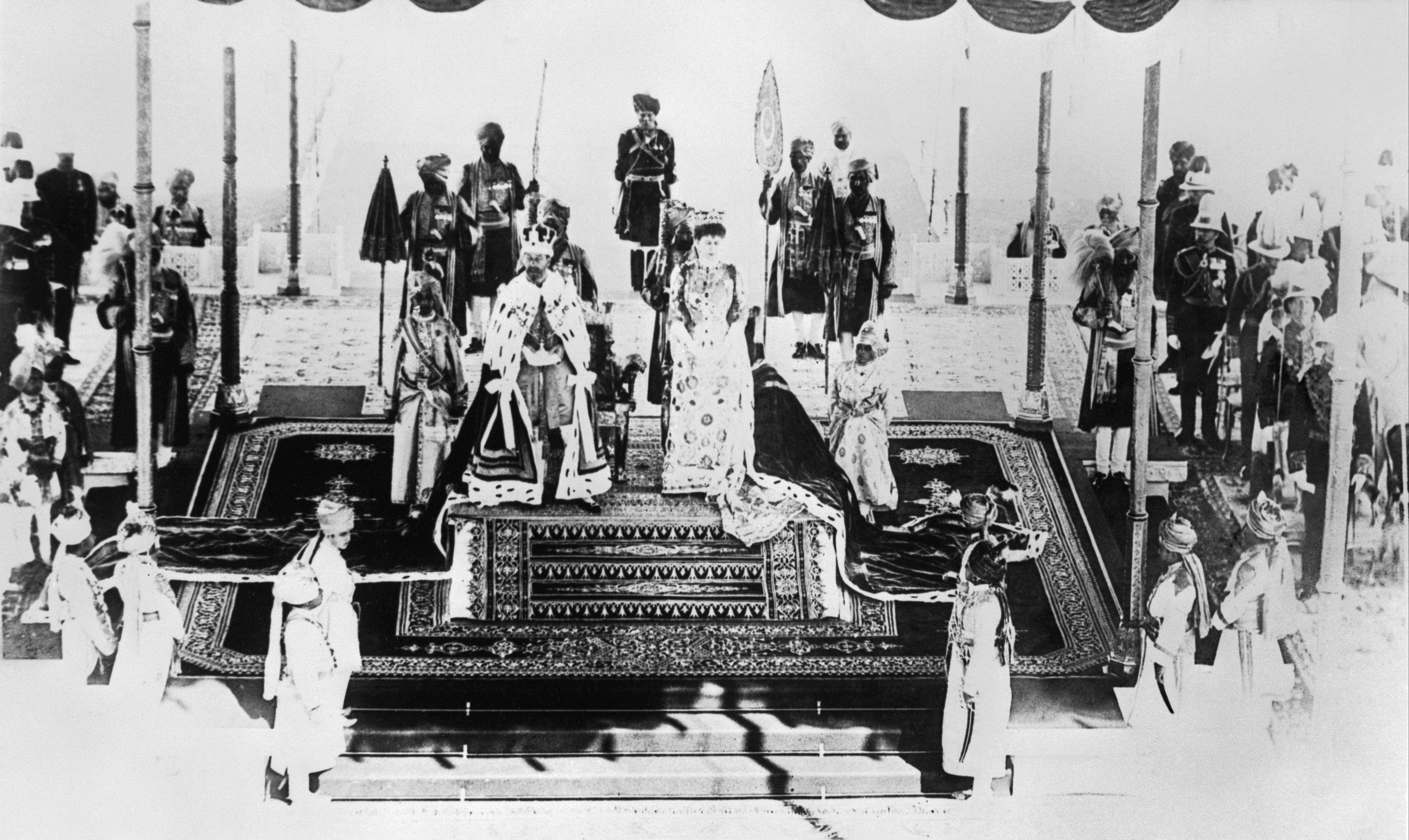 King George V and Queen Mary during the Delhi Durbar, the ceremony at which people of note in India came to pay tribute to the new Emperor and Empress of India following their coronation in Britain, in 1911. The King wears the newly made Imperial Crown of India and both wear their Coronation robes. The Crown had to be made specifically for the occasion as the Imperial State Crown could not be legally removed from Britain. This is photograph Q 107150 from the collections of the Imperial War Museums.