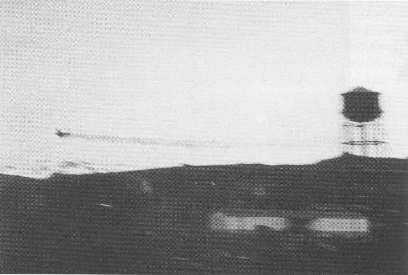 An Imperial Japanese Navy Zero aircraft piloted by Tadayoshi Koga is damaged by anti-aircraft fire over Dutch Harbor, Alaska on 4 June 1942. Koga later crashed the Zero on nearby Akutan island and was killed in the crash. The Zero was recovered by US forces and used for intelligence purposes.