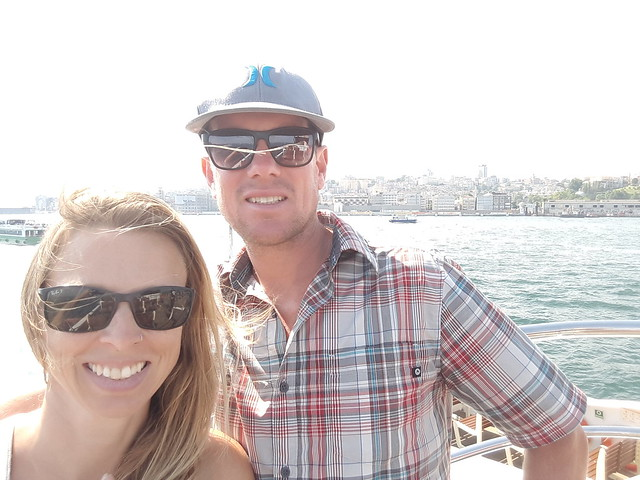 A couple on a boat in the Bosporus Strait, Istanbul, Turkey