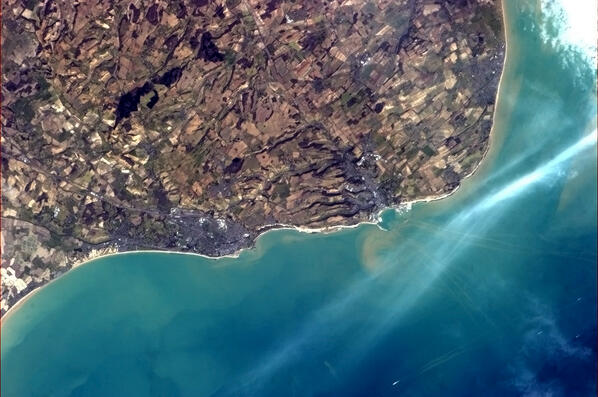 Folkestone and Dover from the International Space Station, showing the White Cliffs and the tracks of ferries. Photo taken on March 6, 2013.