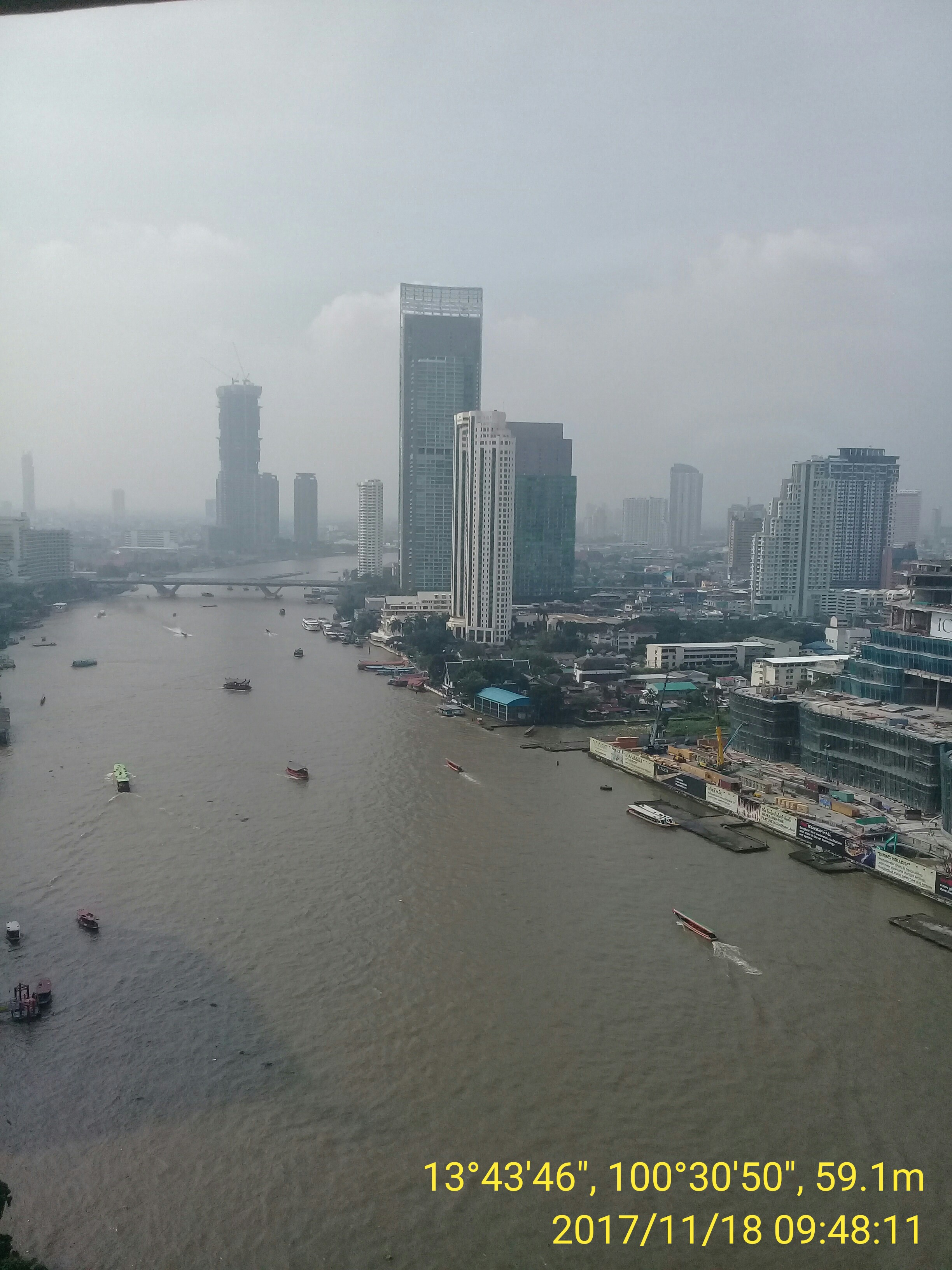 The Chao Phraya River in Bangkok, looking north from the top floor of Sheraton Grande Hotel. Photo taken by Mark Joseph Jochim on November 18, 2017.