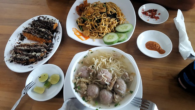 Bakso is the soup with meatballs; the stuff on the left is fried bananas with chocolate by bryandkeith on flickr