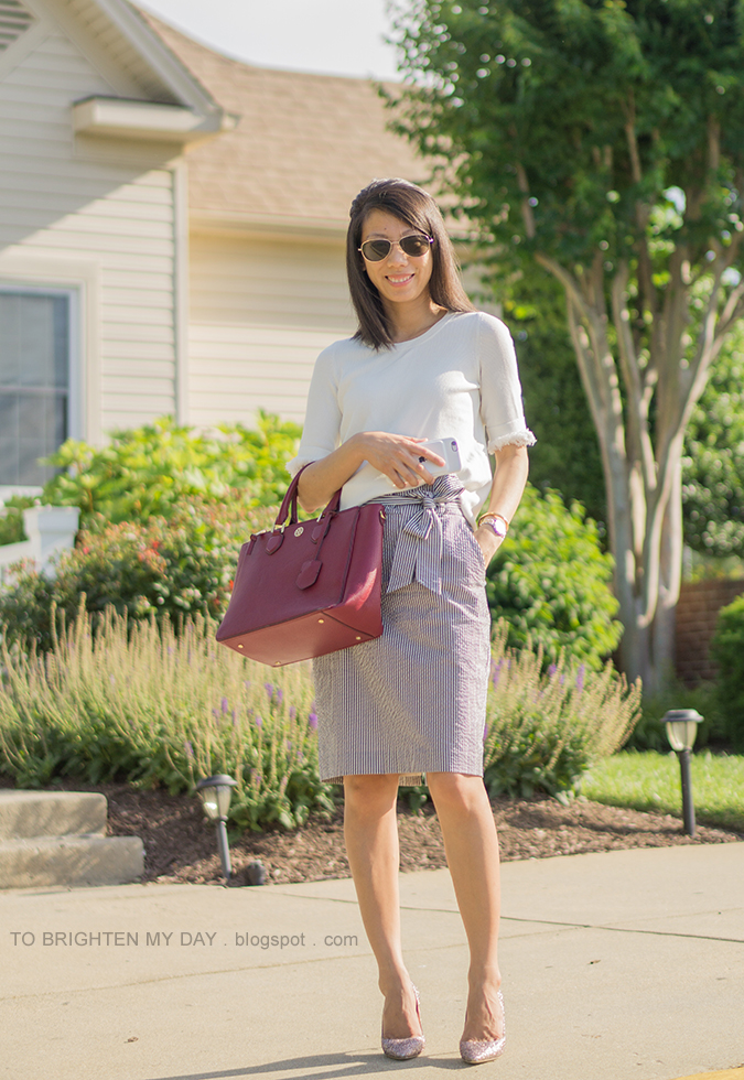 white sweater with fringe, blue striped seersucker pencil skirt with bow tie, two tone watch, rose gold cuff, morganite ring, burgundy red tote, rose gold glitter pumps
