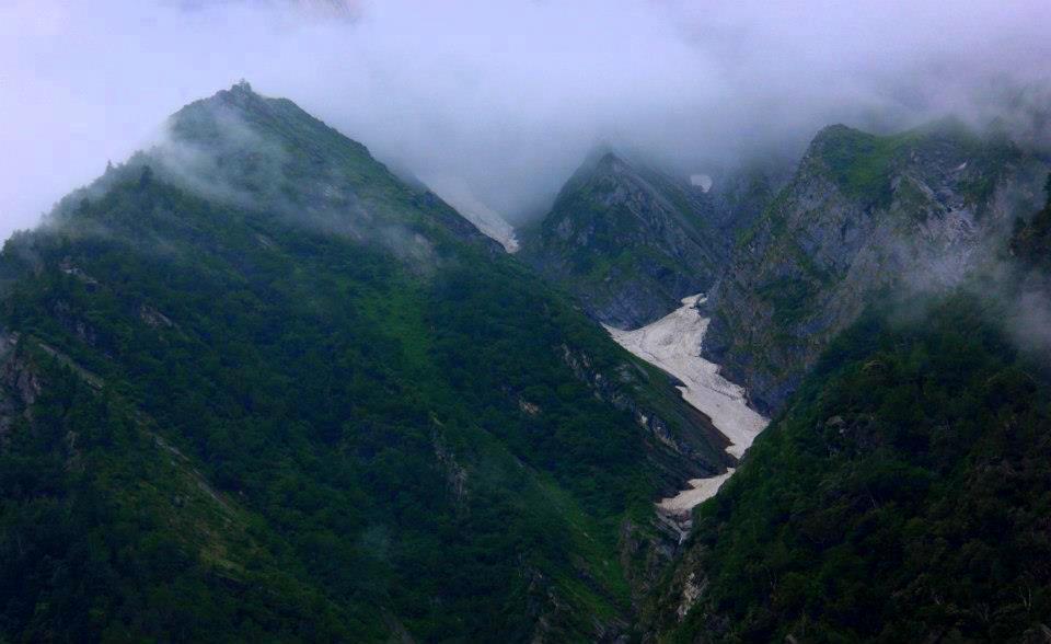 Snow capped peaks circle Hemkund Sahib