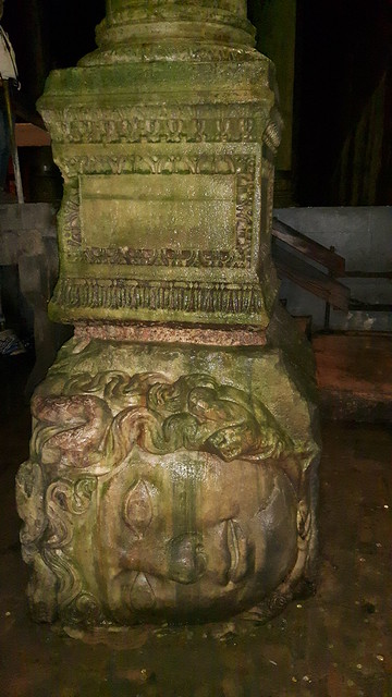 A stone column supported by a sculpture of Medusa's head in the Basilica Cistern, Istanbul