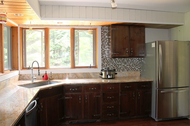 Kitchen with granite counter top and stainless steel appliances
