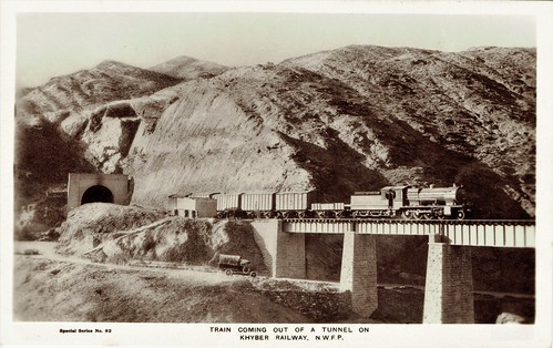 Pakistan Railways - North Western Railway of Pakistan (Khyber Pass) - 2-8-0 steam locomotive and freight train coming out of a tunnel on the Khyber Railway (vintage postcard)