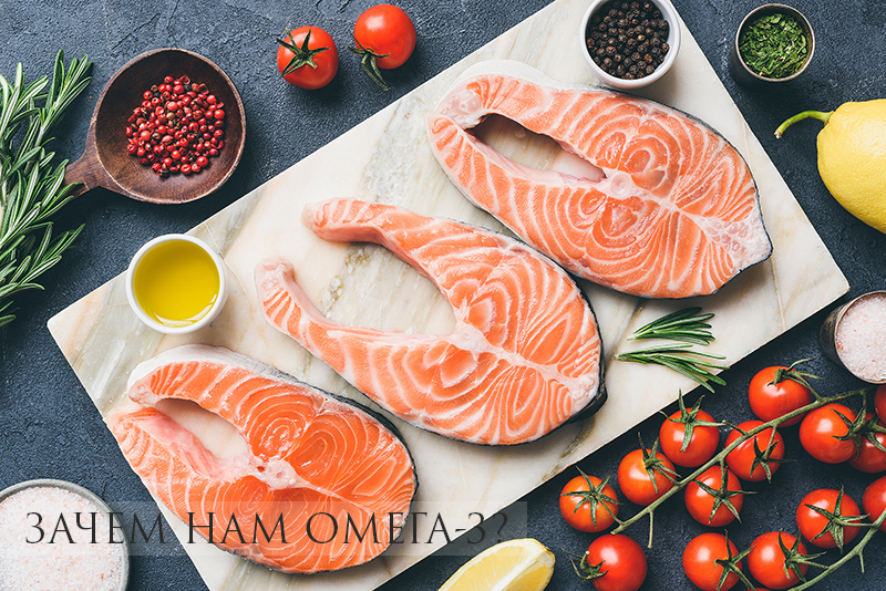 Fresh salmon steaks, herbs, olive oil and cooking ingredients on marble background