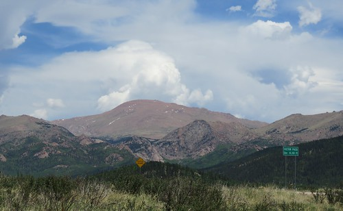pikespeak mountains clouds moountain pass victor colorado highcountry sign cattleguard signs tellercounty