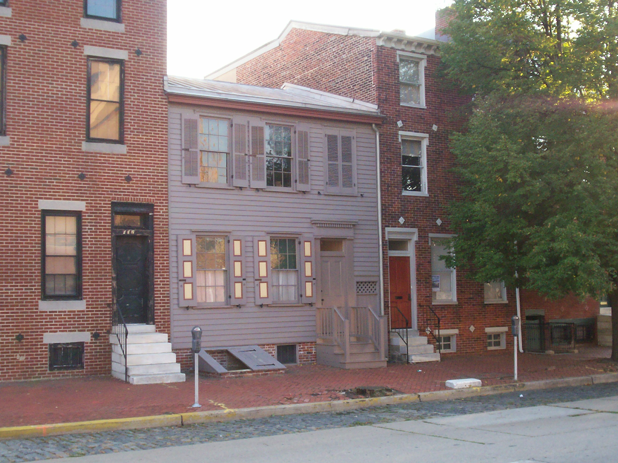The Walt Whitman House in Camden, NJ, where Walt Whitman spent the last years of his life. Note: Whitman's House is the gray one in the middle, not made of brick. The house to the right serves as the Visitors Center. Photo taken on October 13, 2007.