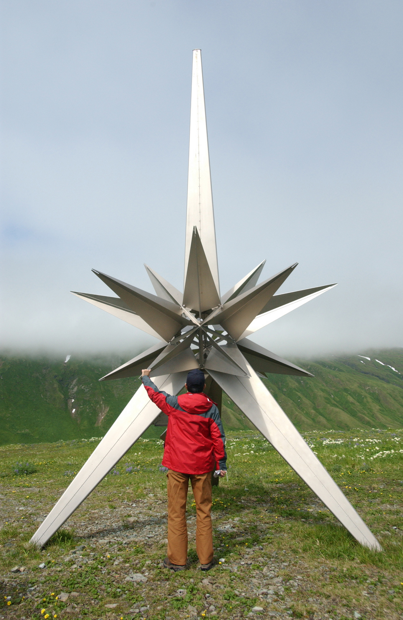 Toshino Makino examines the Peace Monument on Attu Island July 11, 2007. Makino was sent to Attu as part of a Japanese delegation to identify the location of the remains of Japanese soldiers and ensure the titanium monument has not been damaged by the extreme weather of Attu Island.