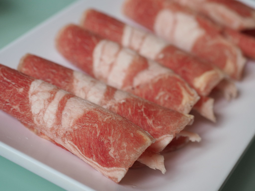 Slices of fresh pork at Good Bar Steamboat at Taichung, Taiwan