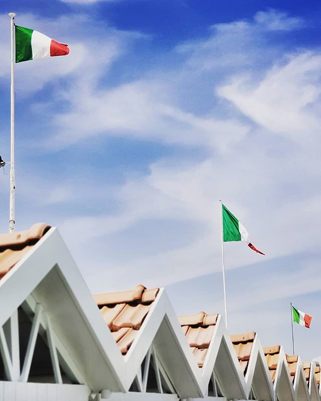 Triangles and flag #sea #flags #italy #italia #triangles #geometry #beach #sky #cabins #colorful #summer #clouds #igers #igersitalia #photooftheday #picoftheday #italy #gurushots
