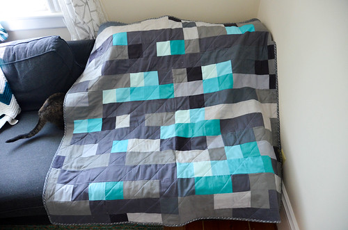 Cat enjoying the Minecraft-inspired quilt, prior to washing & drying