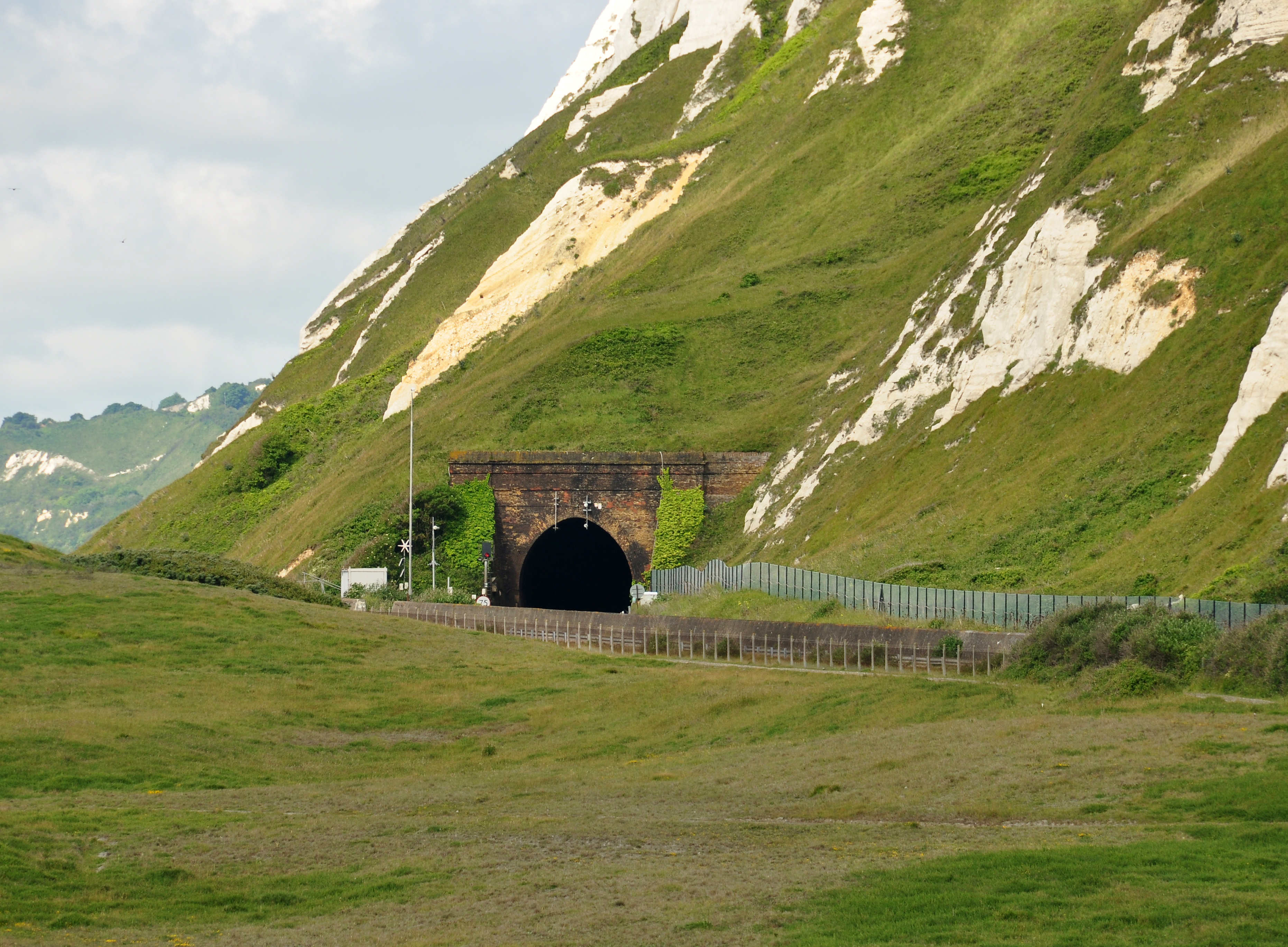 The White Cliffs above Samphire Hoe, near Dover, Kent. The entrance to the tunnel under Abbot's Cliff is visible. Photo taken on June 18, 2012.