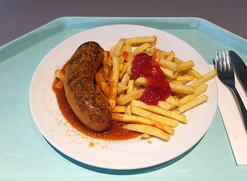 White curried sausage with french fries / Weiße Currywurst mit Pommes Frites