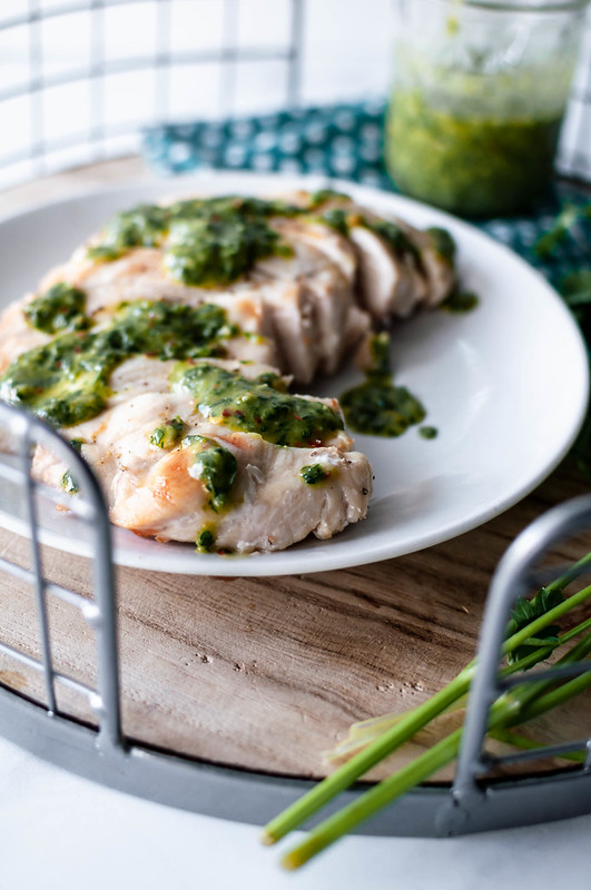 Grilled Chimichurri Chicken is the perfect summertime meal. Light and healthy, bright, fresh and super flavorful. You will want to smother this chimichurri sauce on everything.