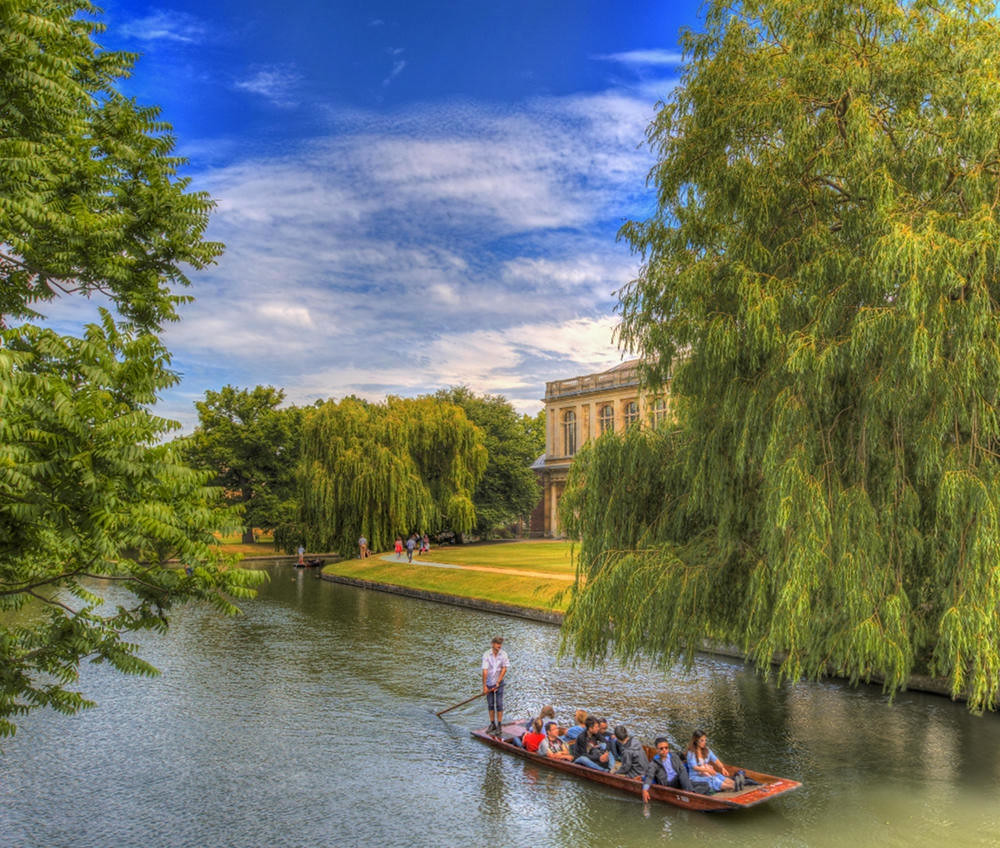 Punting past Trinity College Wren Library, Cambridge. Credit Scudamore's Punting Cambridge, flickr