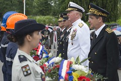 Admiral participates in a wreath laying during a Memorial Day in France.