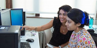 Associate Professor Tania Huedo-Medina works with a student.