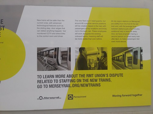 Information sign about Merseyrail's train equipment improvement program