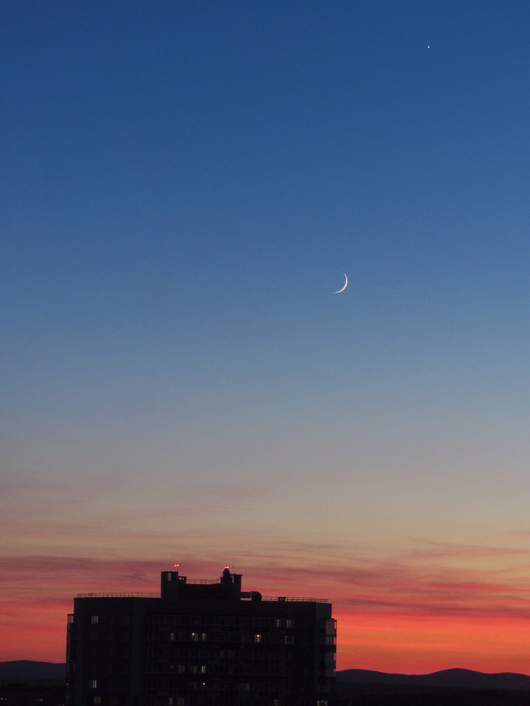Sunset sky with crescent moon and Venus