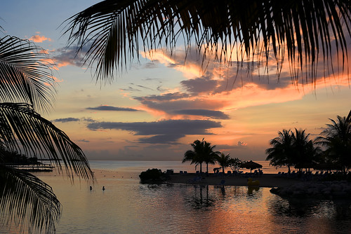 sunset jamaica westindies caribbean littleisland palmtrees loungechairs inflatableduck swimmers water ocean caribbeansea calm peaceful tranquil beautiful pretty lovely gorgeous sky clouds mobay montegobay sundaylights