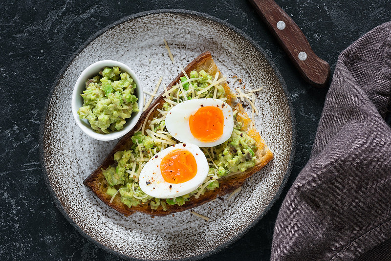 Toast with egg and avocado guacamole top view