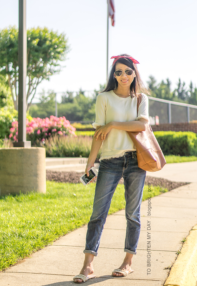 red bandana as headband, white sweater tee, cognac brown tote, girlfriend jeans, fringe embellished sandals