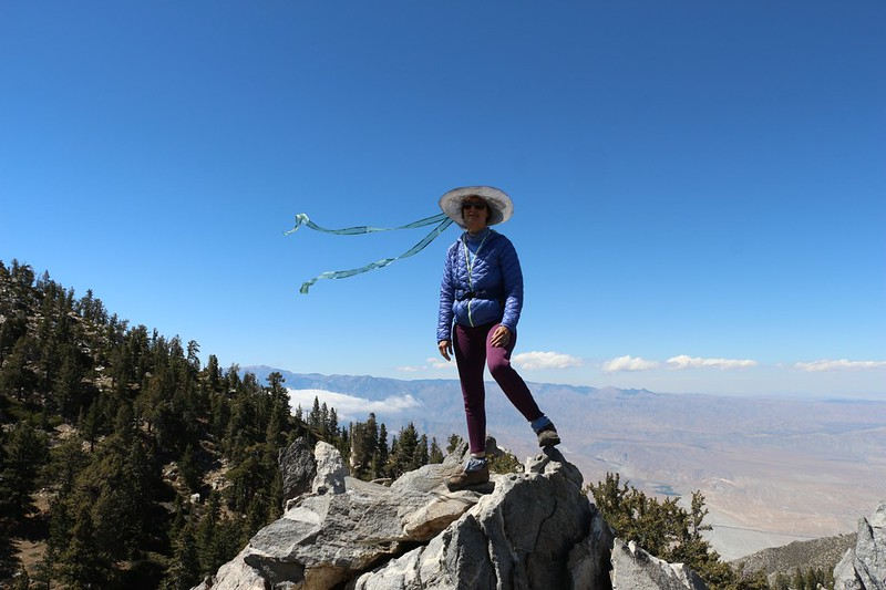 Vicki on the summit of Yale Peak (elevation 9280+ feet) with San Gorgonio Mountain in the background