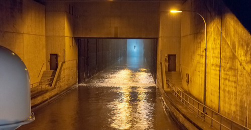 Entrance to  a large lock at night.