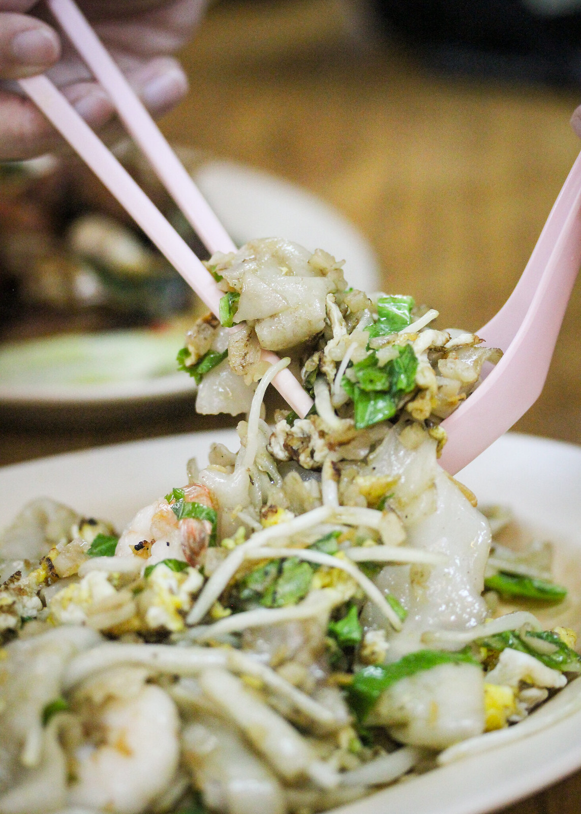 Hao Kee Seafood Deluxe Chye Poh Hor Fun on spoon