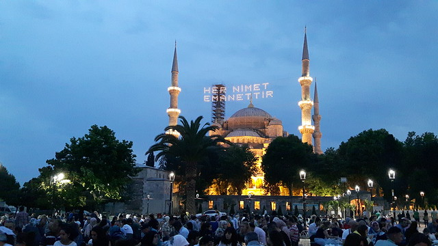 The Blue Mosque lit up for Ramadan with hundreds of people on the ground below. Turkey