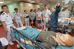 YOKOSUKA, Japan (June 13, 2018) Lt. Kelly Keck speaks to a group of U.S. Navy and Japan Maritime Self-Defense Force sailors during a subject-matter expert exchange aboard the hospital ship USNS Mercy (T-AH 19). Mercy is making port visits to Yokosuka and Tokyo to promote relationships between U.S. Navy Sailors and Japanese citizens through cultural exchange and bilateral training. (U.S. Navy photo by Mass Communication Specialist 2nd Class Jeremy Graham/Released)