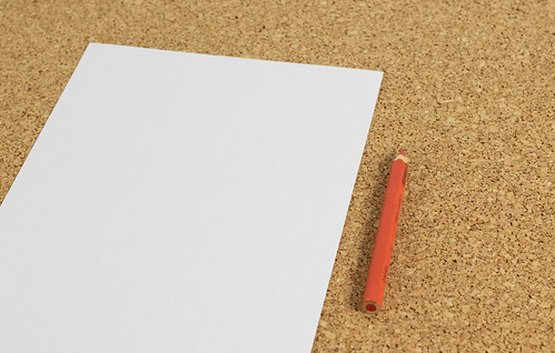 Black white paper with red pencil | by wuestenigel